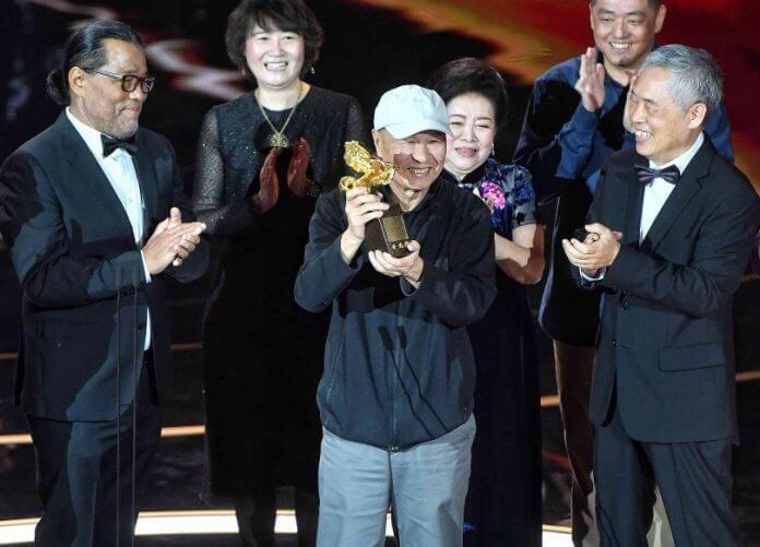 Foto: Tajvanski režiser Hou Hsiao-hsien prejema nagrado za življenjsko delo (CNA).